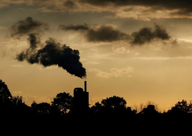 Smoke rises above a factory at sunset in Rugby, Britain February 10, 2021.