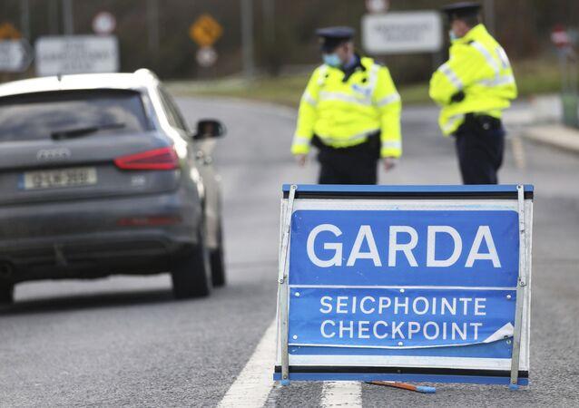 Garda Siochana (Irish Police), patrol a checkpoint close to the Irish border in Ravensdale, Ireland, Monday, Feb. 8, 2021.