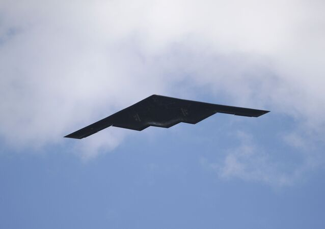 A B-2 Spirit stealth bomber, assigned to the 509th/131st Bomb Wings out of Whiteman Air Force Base, performs a flyover of Barnes-Jewish Hospital to honor healthcare professionals and essential employees fighting against the coronavirus Friday, May 8, 2020, in St. Louis.