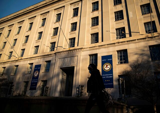 A woman walks past the U.S. Department of Justice Building, in Washington, U.S., December 15, 2020.