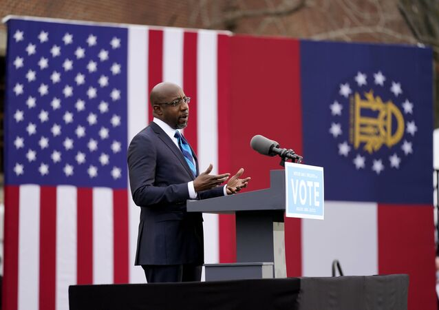 Georgia Democratic candidate for U.S. Senate Raphael Warnock speaks during a drive-in rally Tuesday, Dec. 15, 2020, in Atlanta
