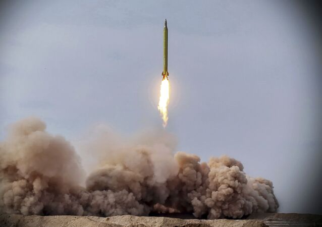 In this photo released on Saturday, Jan. 16, 2021, by the Iranian Revolutionary Guard, a missile is launched in a drill in Iran. Iran's paramilitary Revolutionary Guard conducted a drill Saturday launching anti-warship ballistic missiles at a simulated target in the Indian Ocean, state television reported, amid heightened tensions over Tehran's nuclear program and a U.S. pressure campaign against the Islamic Republic.