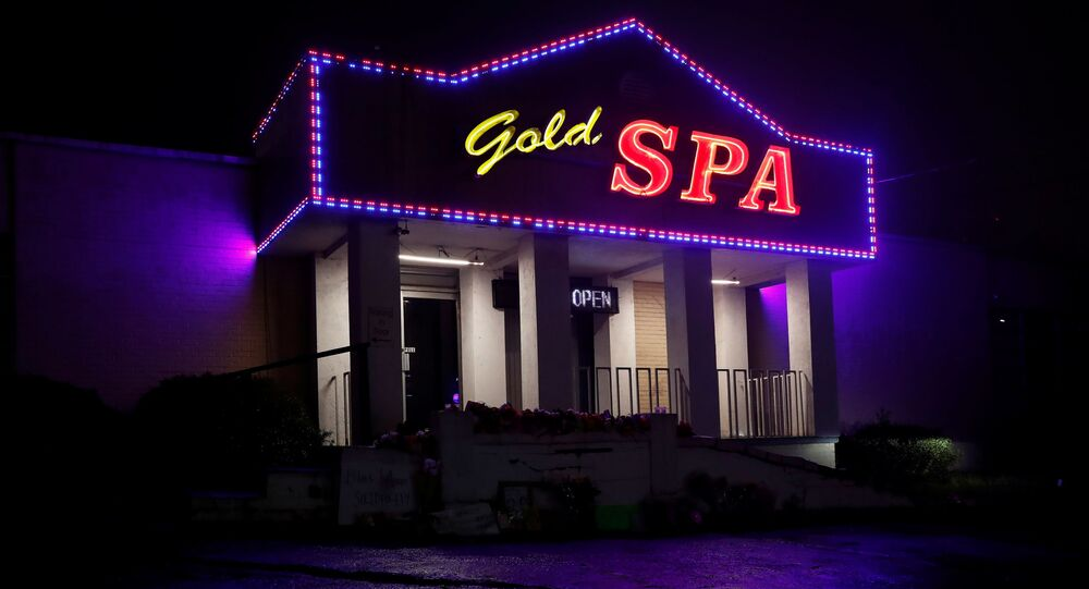 Flowers are laid in front of Gold Spa following the deadly shootings in Atlanta, Georgia, U.S. March 17, 2021.