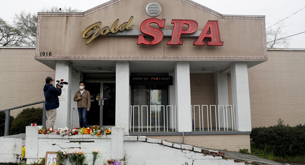 Flowers are laid in front of Gold Spa following the deadly shootings in Atlanta, Georgia, U.S. March 17, 2021