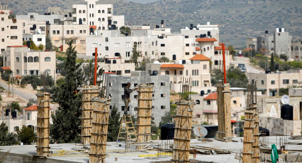 A Palestinian labourer works at the construction site of a house during a lockdown imposed to prevent the spread of the coronavirus disease (COVID-19), in Tubas in the Israeli-occupied West Bank, 15 March 2021