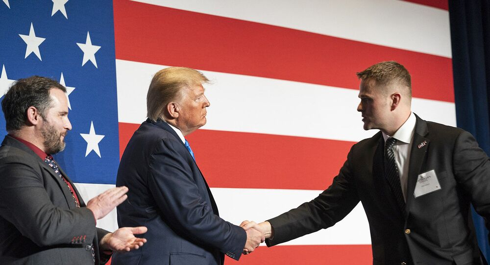 President Donald J. Trump welcomes Army First Lieutenant Clint Lorance and Army Major Mathew Golsteyn to the stage prior to his remarks at the Republican Party of Florida's Statesman Dinner Saturday, Dec. 7, 2019, in Aventura, Fla. Both soldiers were recently granted full pardons by President Trump on November 15th, 2019. (Official White House Photo by Joyce N. Boghosian)