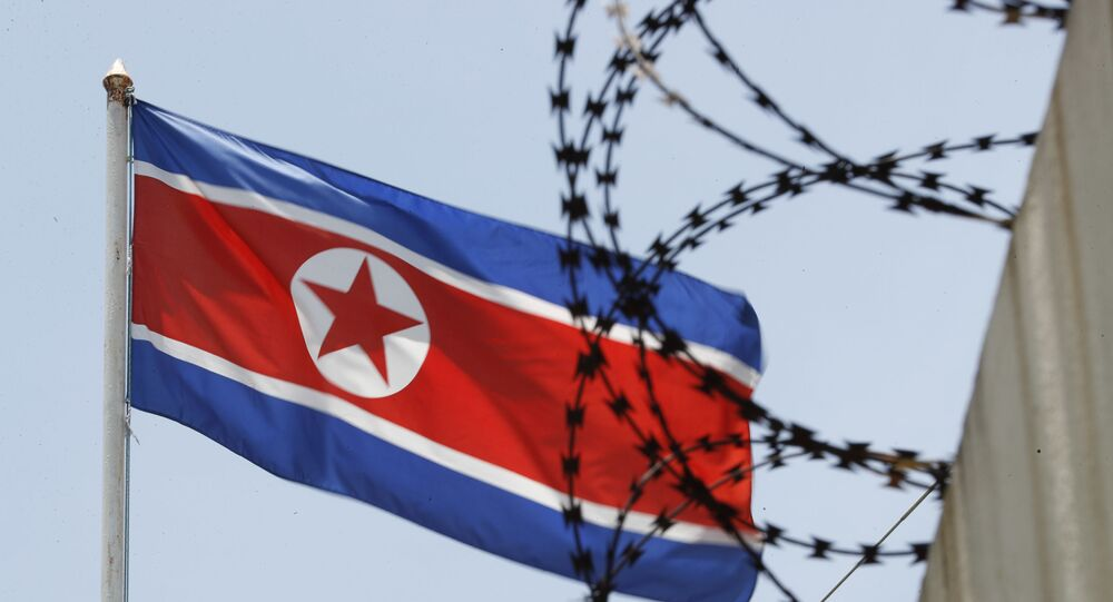 North Korean flag flutters behind razor wire on top of a wall at North Korean Embassy in Kuala Lumpur, Malaysia, Monday, March 13, 2017.