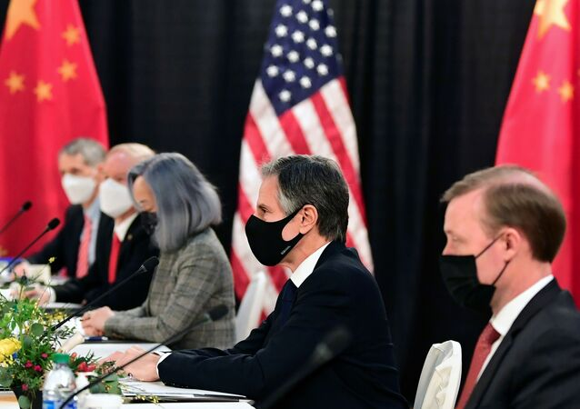 The U.S. delegation led by Secretary of State Antony Blinken (C) and flanked by National Security Advisor Jake Sullivan (R), face their Chinese counterparts at the opening session of U.S.-China talks at the Captain Cook Hotel in Anchorage, Alaska on March 18, 2021.