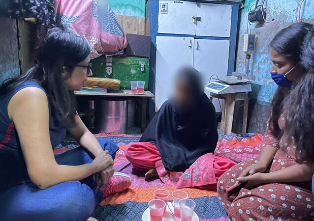 The Delhi Commission for Women chief (left) talking with a 15-year-old girl after saving her from forced marriage.