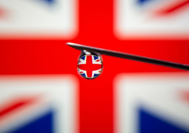 UK flag is reflected in a drop on a syringe needle in this illustration photo taken March 16, 2021. Picture taken March 16, 2021.