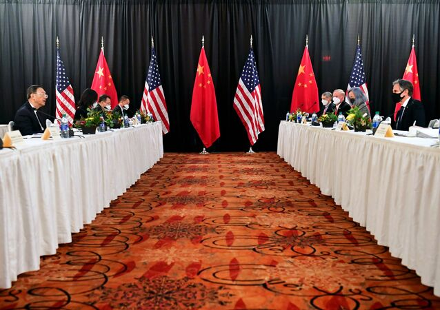 U.S. Secretary of State Antony Blinken (2nd R), joined by National Security Advisor Jake Sullivan (R), speaks while facing Yang Jiechi (2nd L), director of the Central Foreign Affairs Commission Office, and Wang Yi (L), China's State Councilor and Foreign Minister, at the opening session of US-China talks at the Captain Cook Hotel in Anchorage, Alaska, U.S. March 18, 2021