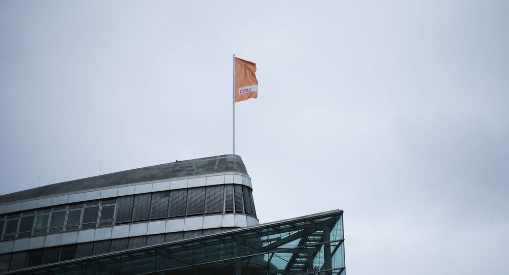 A flag of Germany's Christian Democratic Union party, CDU, the party of Chancellor Angela Merkel, waves in the wind on top of the party's headquarters in Berlin, Germany, March 14, 2021.