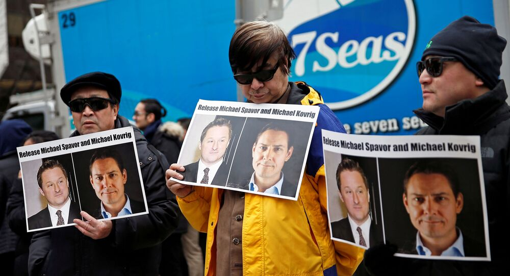 People hold placards calling for China to release Canadian detainees Michael Spavor and Michael Kovrig outside a court hearing for Huawei Technologies Chief Financial Officer Meng Wanzhou at the B.C. Supreme Court in Vancouver, British Columbia, Canada, March 6, 2019.