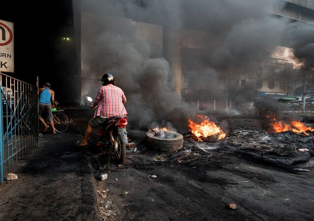 Smoke billows from burning tyres set alight to create smoke cover during a crackdown at Bayint Naung Junction in Yangon, Myanmar March 16, 2021, in this photograph obtained by Reuters.