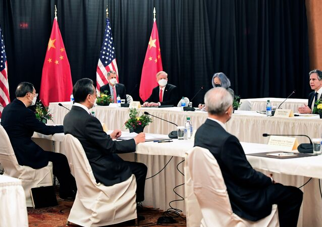 U.S. Secretary of State Antony Blinken (R) speaks while facing Yang Jiechi (L), director of the Central Foreign Affairs Commission Office, and Wang Yi (2nd L), China's State Councilor Wang and Foreign Minister, at the opening session of US-China talks at the Captain Cook Hotel in Anchorage, Alaska on March 18, 2021.