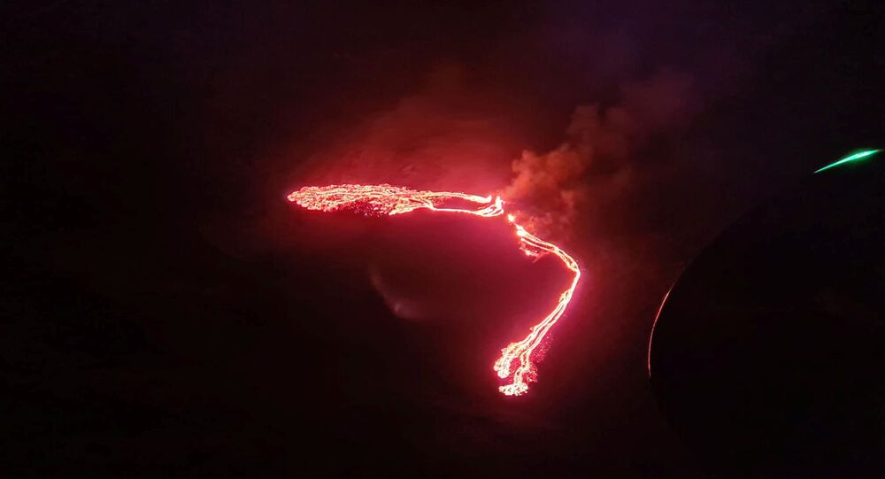 Lava streams are seen during a volcanic eruption in Fagradalsfjall, Reykjanes, Iceland, March 19, 2021 in this still image taken from social media.