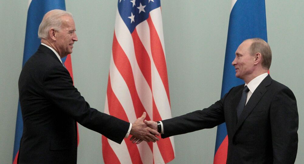 FILE PHOTO: Russia's then-prime minister Vladimir Putin (R) shakes hands with US Vice President Joe Biden during their meeting in Moscow, 10 March 2011.