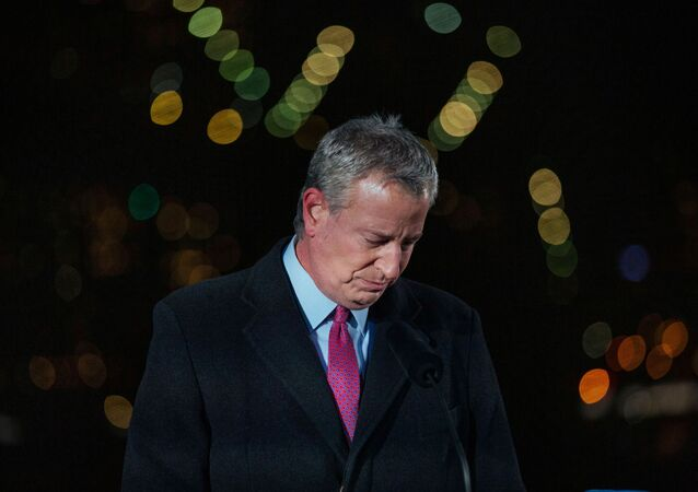 New York City's Mayor Bill de Blasio takes a moment of silence during a commemoration ceremony to remember New Yorkers lost during the COVID-19 pandemic in Brooklyn, New York, U.S. March 14, 2021.