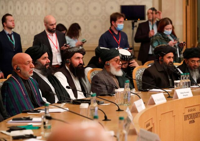 Officials, including Afghan former President Hamid Karzai and the Taliban's deputy leader and negotiator Mullah Abdul Ghani Baradar, attend the Afghan peace conference in Moscow, Russia March 18, 2021. Alexander Zemlianichenko/Pool via REUTERS