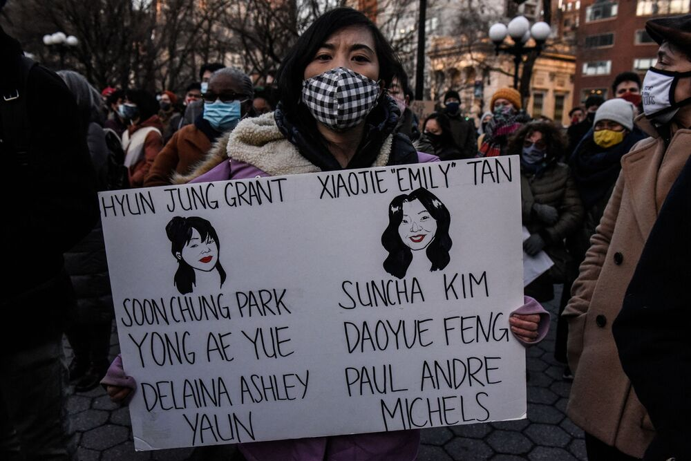 A person holds a sign with the names of the people who died at a peace vigil to honour victims of attacks on Asians on 19 March 2021 in Union Square Park in New York City.