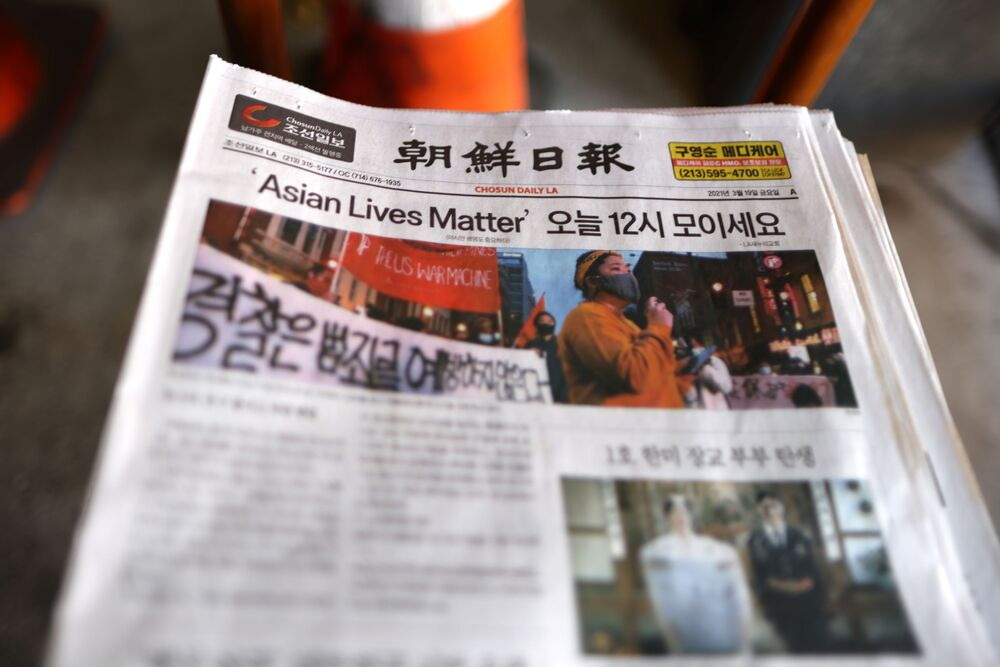 A Los Angeles Koreatown newspaper is seen at a protest to denounce hate against the Asian American and Pacific Islander communities, following the deadly shootings at Young's Asian Massage in Georgia, in Koreatown in Los Angeles, California, U.S., 19 March 2021.