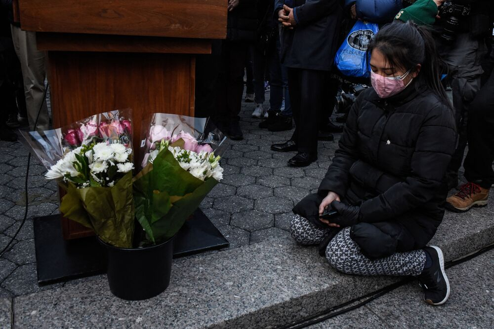People participate in a peace vigil to honor victims of attacks on Asians on 19 March 2021 in Union Square Park in New York City.
