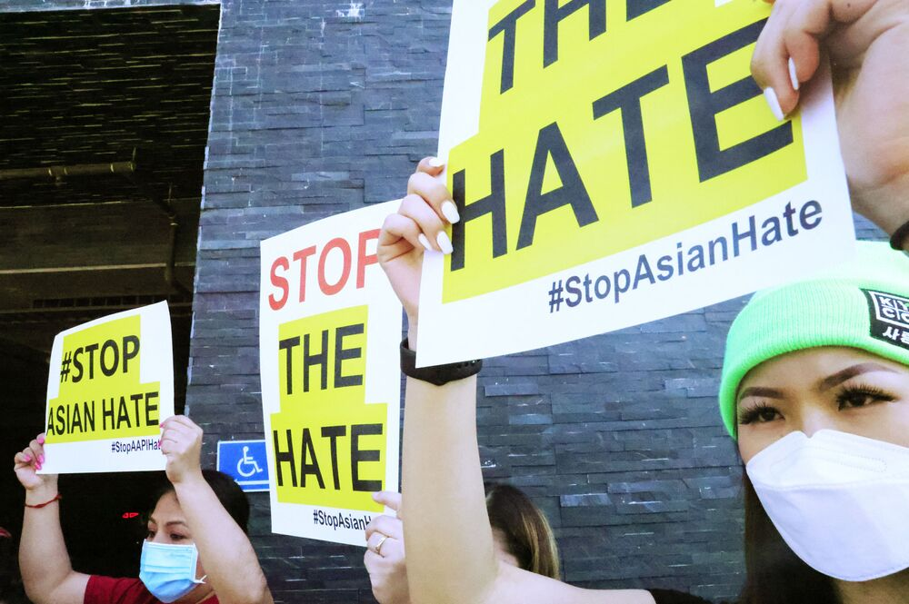 People protest hate crimes committed against Asian-American and Pacific Islander communities ahead of a car caravan in Koreatown on 19 March 2021 in Los Angeles, California.