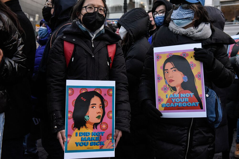 People participate in a peace vigil to honour victims of attacks on Asians on 19 March 2021 in Union Square Park in New York City.