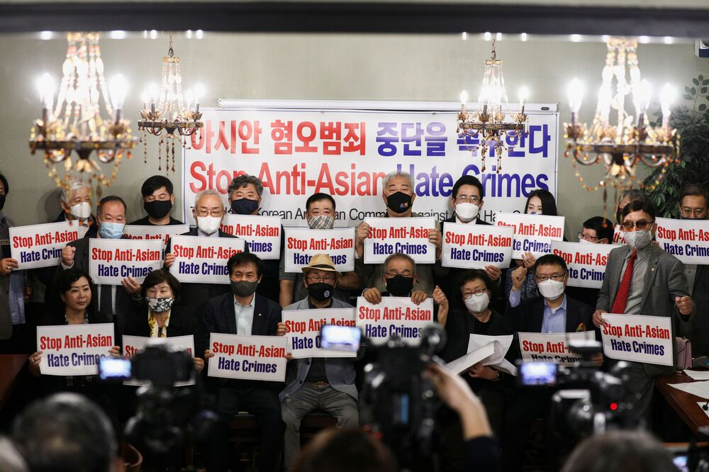 Members of the Atlanta Korean American Committee against Asian Hate Crime pose with placards during a group photo as they meet at Ching Dam, a Korean restaurant, after the fatal shooting at three Georgia spas, in Duluth, Georgia, U.S., 18 March 2021.