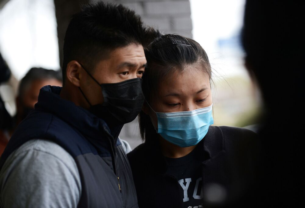 Kevin Chen consoles his fiancee Jami Webb outside Young's Asian Massage following the deadly shootings in Acworth, Georgia, U.S. March 19, 2021. Webb is the daughter of Xiaojie Tan, the owner of the spa who was killed in the shootings.