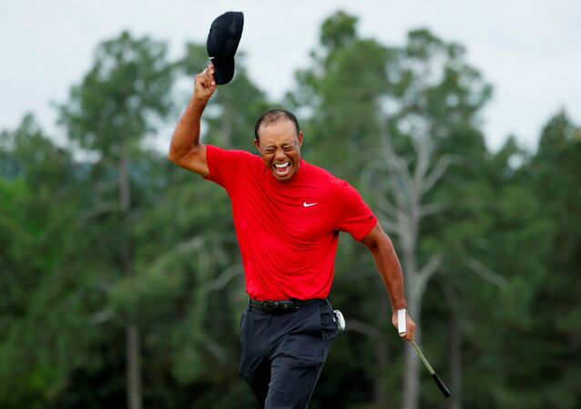 Golf - Masters - Augusta National Golf Club - Augusta, Georgia, 14 April 2019 - Tiger Woods of the U.S. celebrates on the 18th hole after winning the 2019 Masters