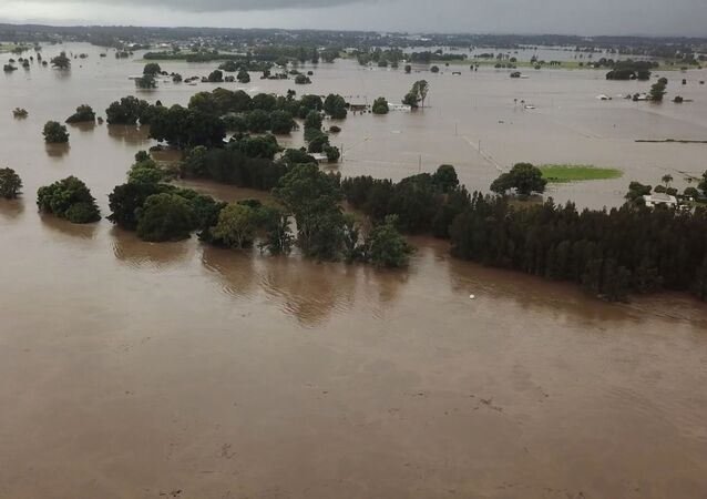 A general view shows flooding following heavy rainfall in Tinonee, New South Wales, Australia March 20, 2021, in this still image taken from drone video obtained from social media.