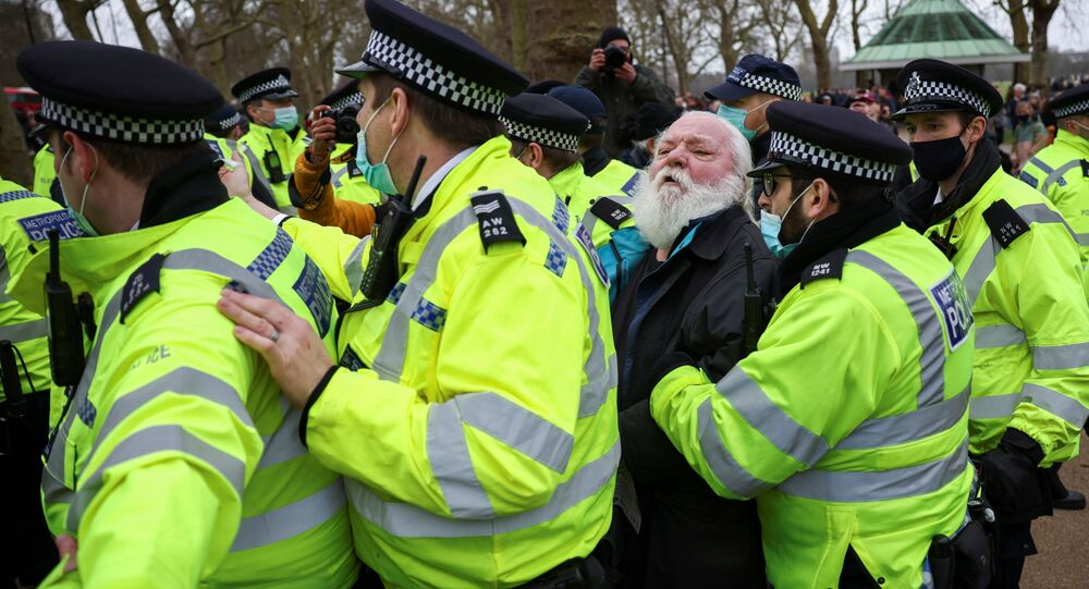 Police officers detain a demonstrator in Hyde Park during a protest against the lockdown, amid the spread of the coronavirus disease (COVID-19), in London, Britain March 20, 2021.