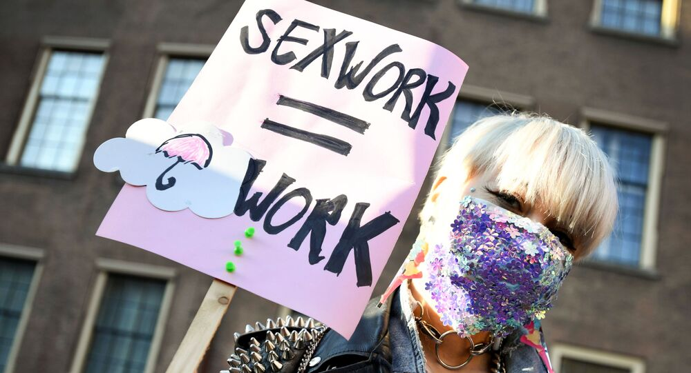 A protester holds a placard as Dutch sex workers demonstrate to demand the right to go back to work, amid the coronavirus disease (COVID-19) pandemic, in The Hague, Netherlands March 2, 2021