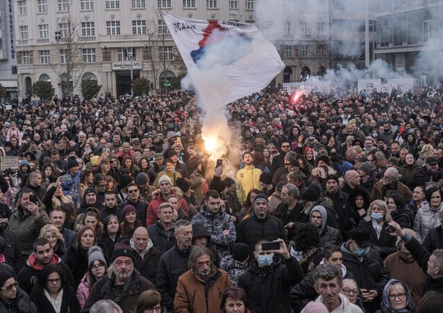 People take part in a protest against the coronavirus disease (COVID-19) measures in Belgrade, Serbia, March 20, 2021.