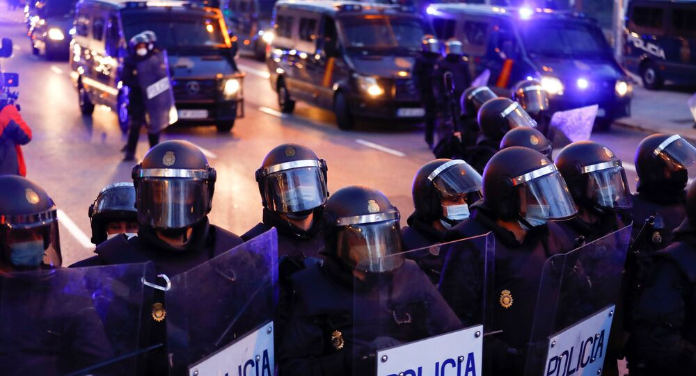 Police officers stand in formation during a protest in support of Catalan rap singer Pablo Hasel in Madrid, Spain, March 20, 2021.
