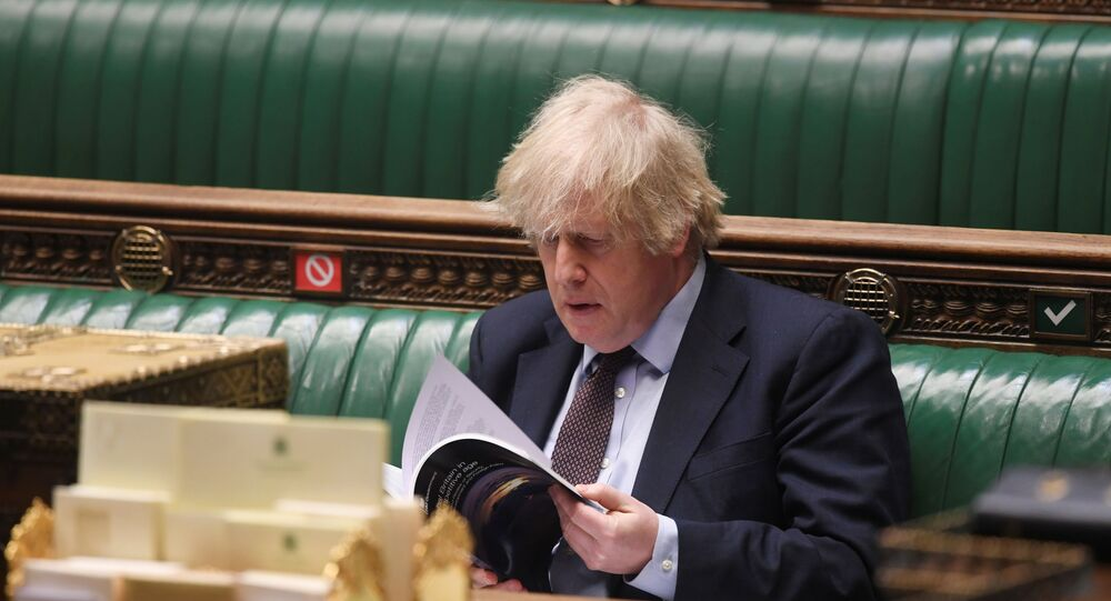 Britain's Prime Minister Boris Johnson attends a parliament session at the House of Commons in London, Britain March 16, 2021