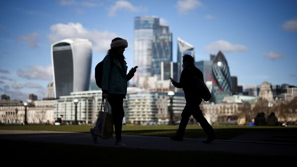 The City of London financial district can be seen as people walk along the south side of the River Thames, amid the coronavirus disease (COVID-19) outbreak in London, Britain, March 19, 2021 - Sputnik International