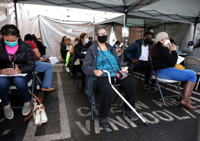 Leticia Robles, 70, sits in the observation area after receiving a coronavirus disease (COVID-19) vaccination, at Jordan Downs in Los Angeles, California, U.S., March 10, 2021.