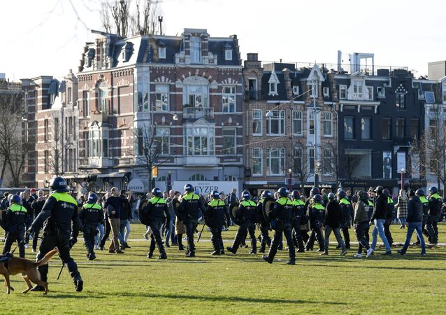 Police officers are seen, as people protest against the coronavirus disease (COVID-19) restrictions in Amsterdam, Netherlands, February 21, 2021.