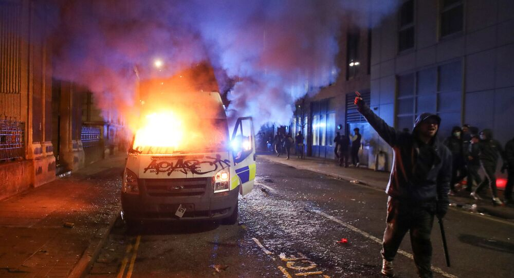 10 arrested as riot police disperse anti-lockdown protesters in UK's Bristol