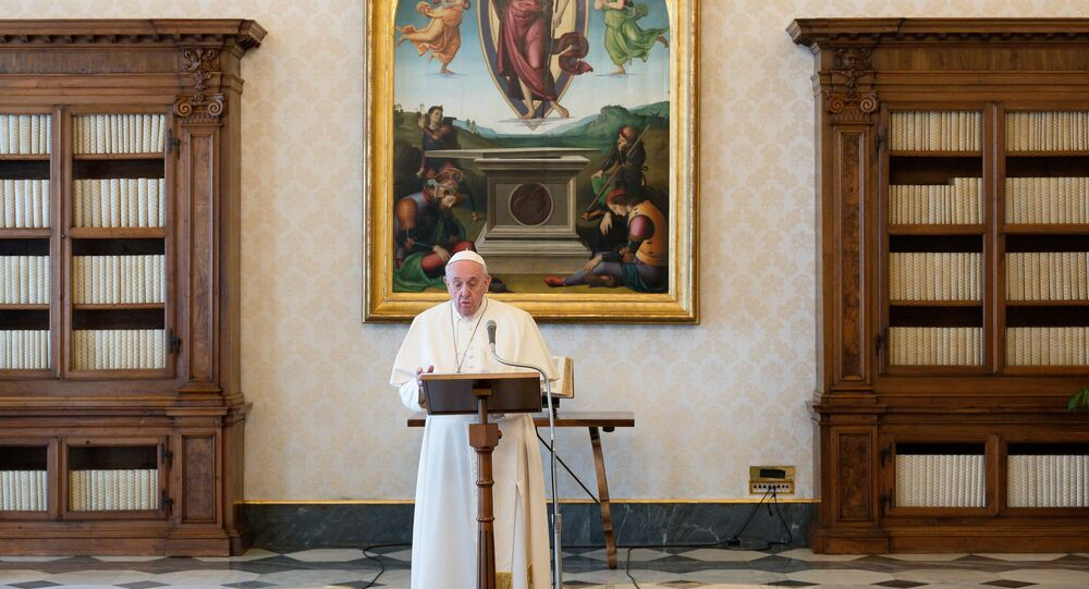 Pope Francis leads Angelus prayer at the library of the Apostolic Palace in the Vatican March 21, 2021.