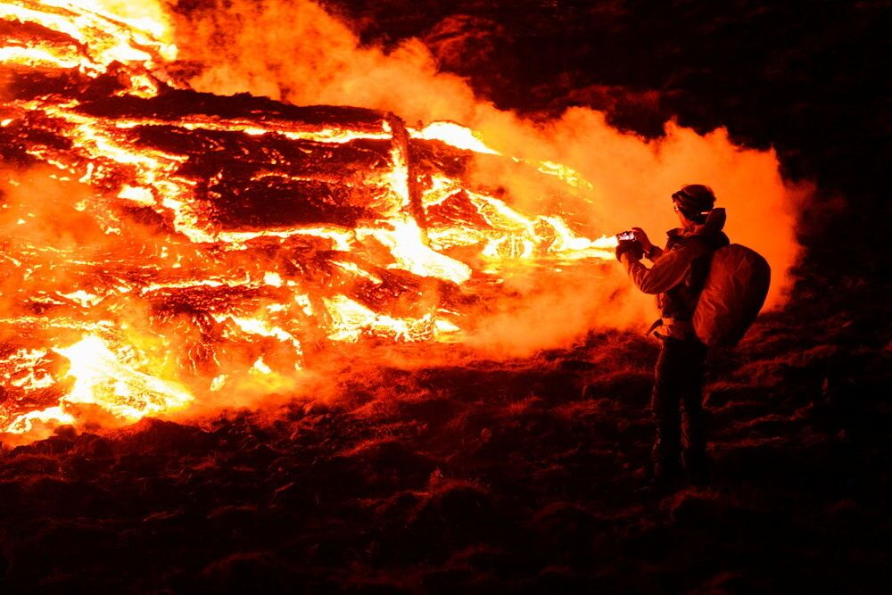 Lava flows from a volcano in Reykjanes Peninsula, Iceland 20 March 2021 in this picture obtained from social media.