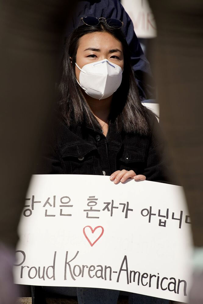 Sophia Sim holds a sign as she attends a Stop Asian Hate rally at the Logan Square Monument in Chicago, Illinois, on Saturday, 20 March 2021. A diverse crowd gathered to demand justice for the victims of the Atlanta, Georgia spa shootings, as well as for an end to racism, xenophobia, and misogyny.