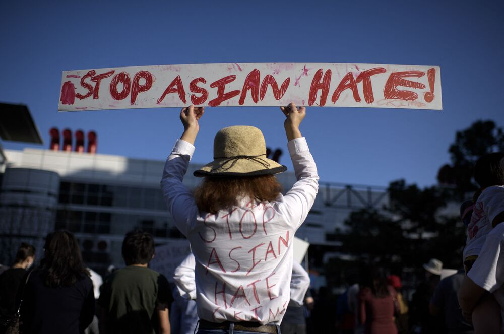 Sally Sha holds up a sign during a Stop Asian Hate rally at Discovery Green in downtown Houston, Texas on 20 March 2021.