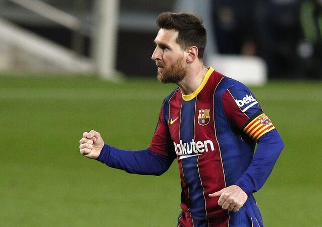 Soccer Football - La Liga Santander - FC Barcelona v SD Huesca - Camp Nou, Barcelona, Spain - March 15, 2021 Barcelona's Lionel Messi celebrates scoring their fourth goal