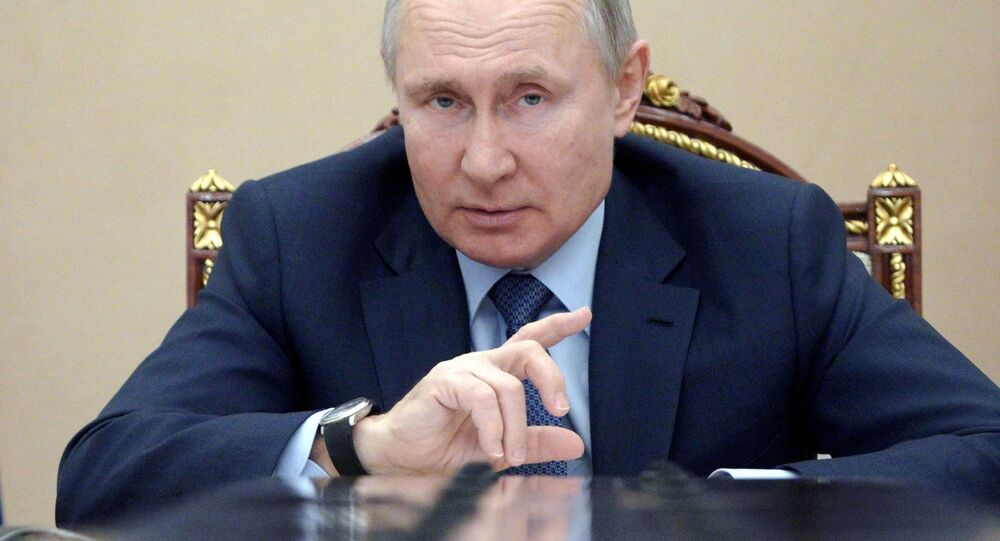 Russian President Vladimir Putin attends a meeting with government members via a video link in Moscow, Russia March 10, 2021