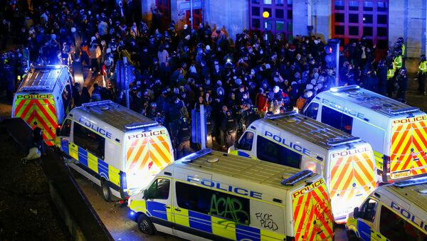 Demonstrators gather outside a police station during a protest against a new proposed policing bill, in Bristol, Britain, March 21, 2021.  - Sputnik International