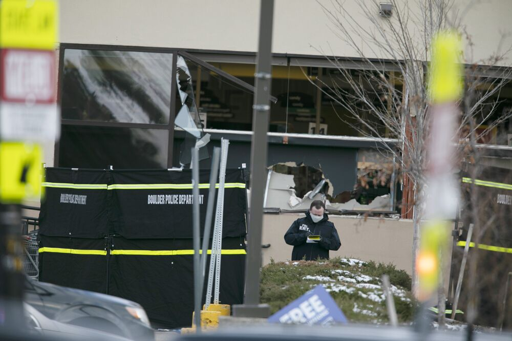 Police work on the scene outside of a King Soopers grocery store where authorities say multiple people were killed in a shooting, Monday, 22 March 2021, in Boulder, Colorado.