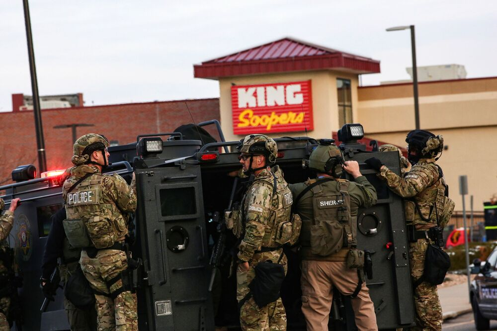 Law enforcement officers in tactical gear are seen at the site of a shooting at a King Soopers grocery store in Boulder, Colorado, 22 March 2021.